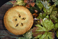 Apple pie with autumn leaves Stock Photo