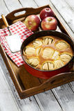 Apple pie in baking dish on tablet Stock Photography