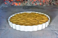 Apple pie baking in the oven stock image