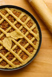 Apple pie in baking tray, wooden rolling pin Stock Photo