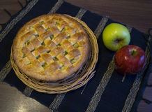 Apple pie. Apple pie on a black tablecloth with green and red apple Stock Photos