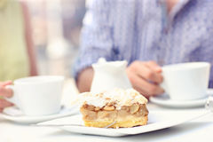 Apple pie in a cafe. A picture of a piece of apple pie served on a white plate in a cafe Stock Images