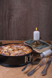 Apple pie with candle and old books Royalty Free Stock Photos