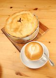 Apple Pie and Cappuccino Coffee. Freshly baked Apple Pie and a cup of cappuccino coffee on a wooden restaurant table stock photos