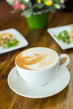 Apple pie and cappuccino on a wooden table Royalty Free Stock Photos