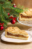 Apple pie in christmas setting. Cake on wooden table,. Christmas tree in the background Stock Photo