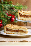 Apple pie in christmas setting. Cake on wooden table, Royalty Free Stock Photo