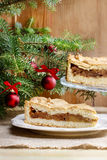 Apple pie in christmas setting. Cake on wooden table, Royalty Free Stock Image
