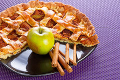 Apple pie with cinnamon. Apple tart with cinnamon on the plate Royalty Free Stock Photography