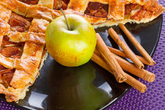 Apple pie with cinnamon. Apple tart with cinnamon on the plate Stock Photo