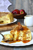 Apple pie with cinnamon and caramel sauce. Royalty Free Stock Photo