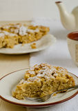 Apple pie. With cinnamon and cup of tea on the table Royalty Free Stock Photo