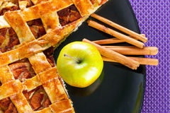 Apple pie with cinnamon dessert. Apple tart with cinnamon on the plate Stock Images
