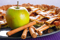 Apple pie with cinnamon dessert. Apple tart with cinnamon on the plate Royalty Free Stock Photos