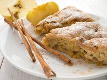 Apple pie and cinnamon sticks Stock Photo