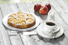 Apple pie, coffee cup and plate, apples on wood Royalty Free Stock Photography