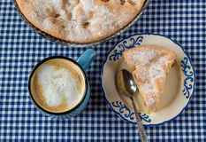 Apple pie and coffee mug. On the table royalty free stock photography