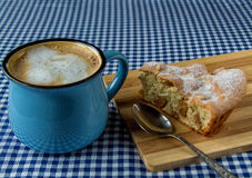 Apple pie and coffee mug. On the table stock image