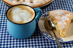 Apple pie and coffee mug. On the table royalty free stock photo