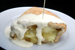 Apple pie with cream. On a black background royalty free stock photography