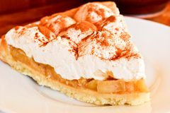 Apple pie with a cream Royalty Free Stock Images