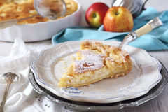 Apple pie with cream. Apple tart with cream and two red apples Stock Photography