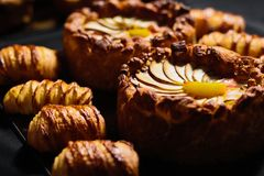 Apple pie and croissant. Apple pie and сroissant on table. Studio shoot royalty free stock images