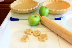 Apple pie crust and dough leaves. Preparation for baking and apple pie with organic apples Royalty Free Stock Images