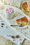 Apple pie with a cup of cocoa drink and marshmallow. Delicious dessert after lunch. Light Photo. The local focus Royalty Free Stock Photography