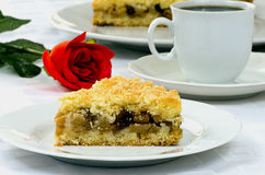 Apple pie with a cup of coffee and red rose Stock Photos