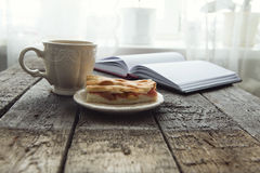 Apple pie with cup of coffee on table Stock Image