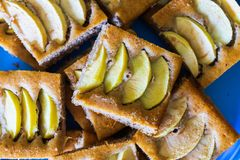 Apple pie cut into slices royalty free stock photography