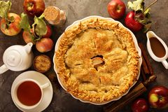 Apple pie decorated with fall leaves royalty free stock photography