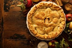 Apple pie decorated with fall leaves Stock Images
