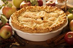 Apple pie decorated with fall leaves Royalty Free Stock Photos