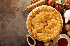 Apple pie decorated with fall leaves royalty free stock images