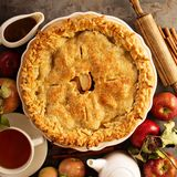 Apple pie decorated with fall leaves stock photos