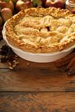 Apple pie decorated with fall leaves royalty free stock image