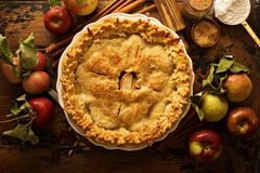 Apple pie decorated with fall leaves Stock Image