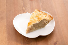 Apple pie. Detail on wood table Stock Image