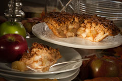 Apple pie in dining room setting. Slice of deicious apple pie stock images