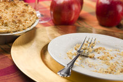 Apple Pie and Empty Plate with Remaining Crumbs Royalty Free Stock Photography