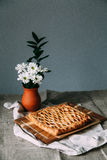 Apple pie. With flowers. Yekaterinburg royalty free stock image