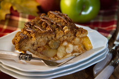 Apple pie with fork and apples. Slice of deicious apple pie royalty free stock photos