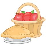 Apple Pie and  fresh apples in a basket Royalty Free Stock Photo