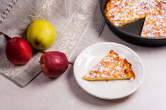 Apple pie with fresh fruits on light marble background. Royalty Free Stock Image