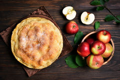 Apple pie and fresh fruits, top view Stock Image