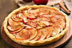 Apple pie with fresh fruits on wooden table, top view Royalty Free Stock Photography