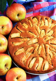 Apple Pie. Freshly baked apple pie with apples in the background Stock Photo