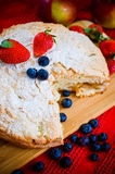 Apple pie and fruits. Apple pie with strawberries and blueberries Royalty Free Stock Photo